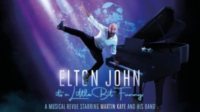 Elton John - title image featuring the show's star Martin Kaye suspended in the air with a piano